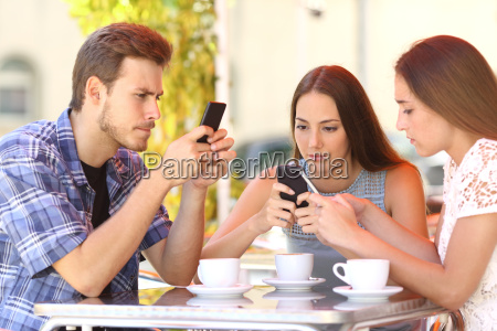 group of phone addicted friends in