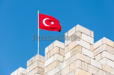 turkish flag on fort battlements
