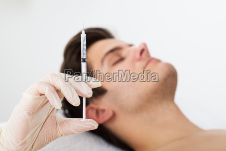 man getting wrinkle treatment from doctor