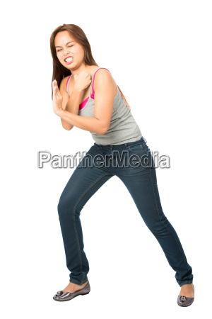 straining woman leaning shoulder against object
