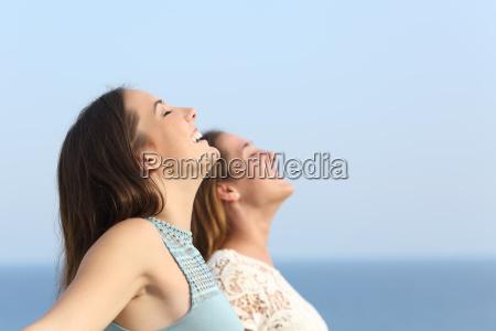 two girls breathing deep fresh air