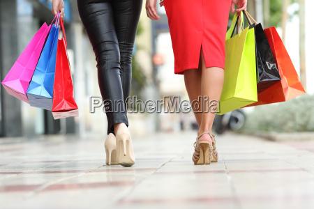 two fashion women legs walking with