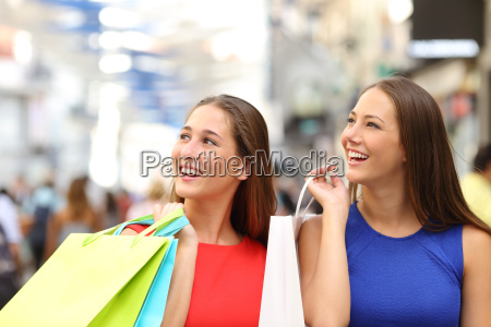two friends shopping in a mall