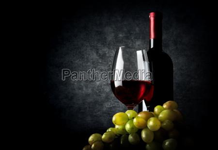 wine with grape on black