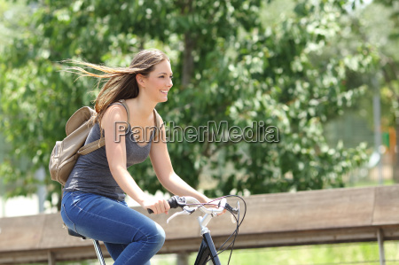 cyclist woman riding bicycle in a