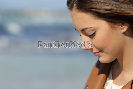melancholic woman thinking on the beach