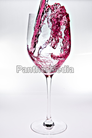 glass with red wine against a