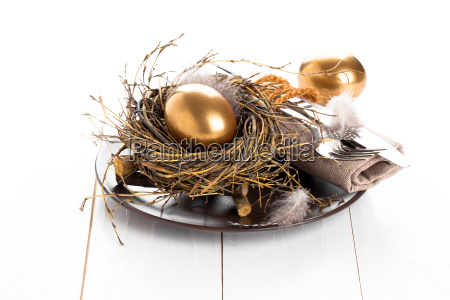 golden egg table decoration on a