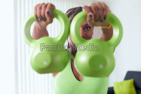 home fitness black woman training shoulders