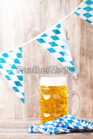 beer glass with wood background october