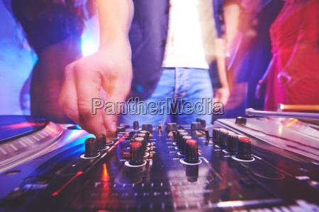 deejay adjusting sound