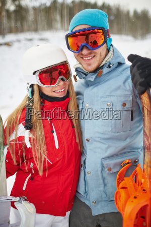 happy young snowboarders