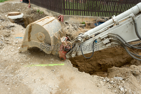 excavator ploughshare on trench constructing