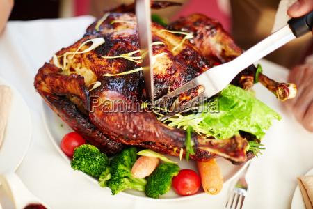cutting roasted turkey