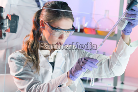 young scientist pipetting in life science
