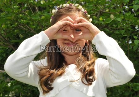 communion child pretty girl with white