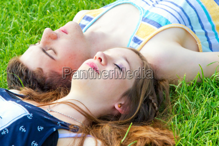 young happy couple in the grass