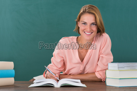 female teacher studying at desk