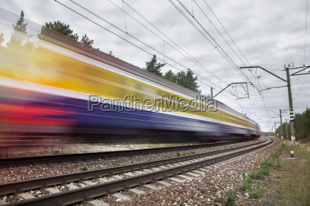 passenger train on railroad tracks in