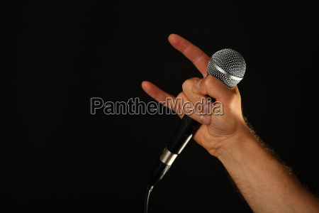 hand with microphone and devil horns