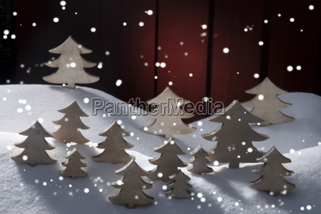 four white wooden christmas trees snow