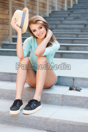 pretty girl in trendy outfit sitting