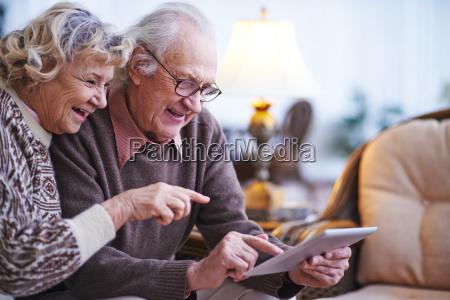 seniors with digital tablet