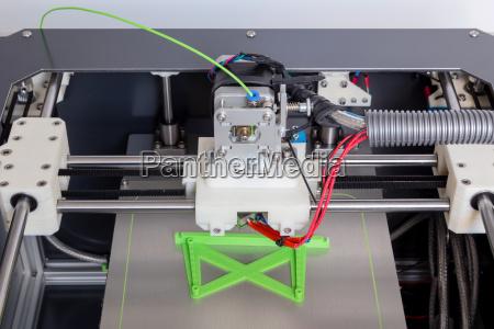 3d printer with bright green filament