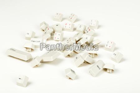scattered keyboard keys on white