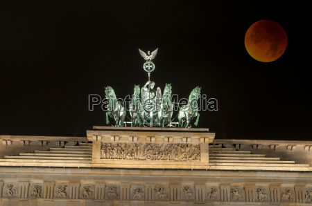 brandenburg gate with blood moon berlin