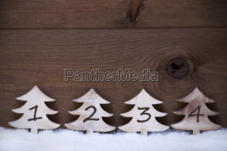 wooden christmas trees on snow copy