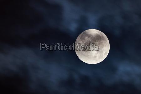 big silver moon at the cold