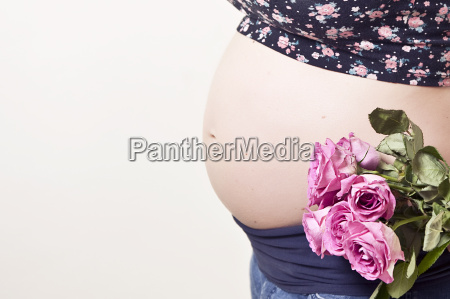 pregnancy belly with roses