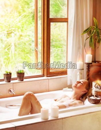 happy woman bathing