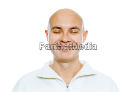 bald smiling man with his eyes