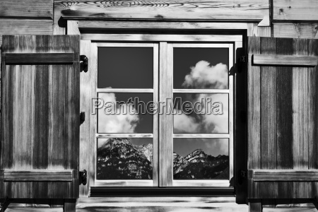 cottage window with mountain views in