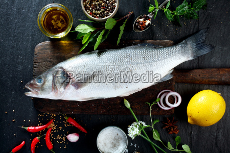 whole fish on wooden board with