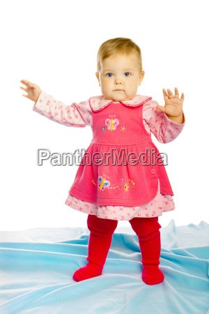 baby girl in a dress standing