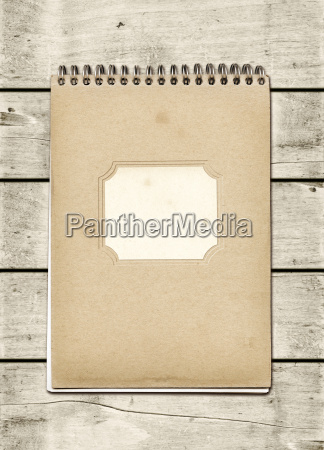closed spiral note book on a