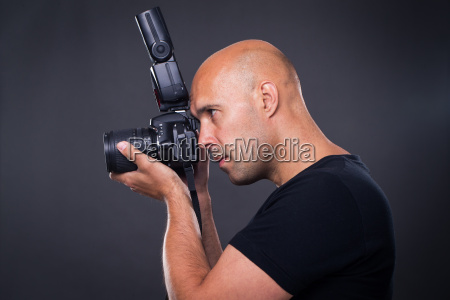 young pro male photographer in his