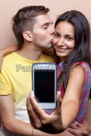 young couple taking a selfie with