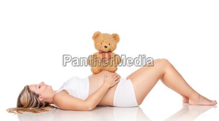 teddy bear sitting on a belly