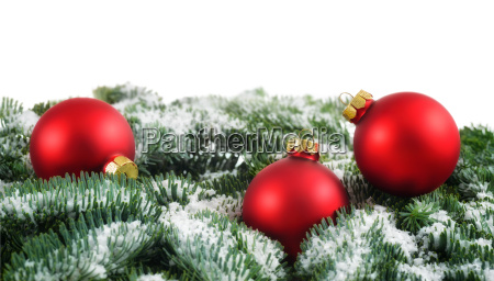 red christmas baubles and snow on