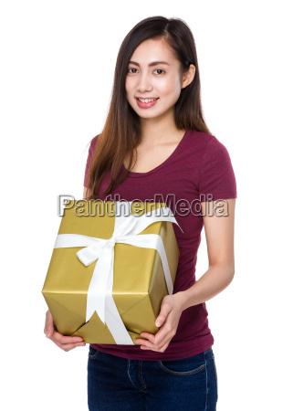 young, girl, holding, a, big, giftbox - 14932719