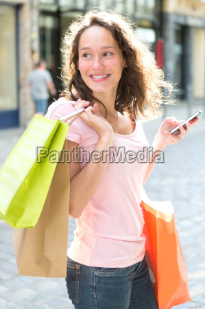 young attractive woman using mobile during