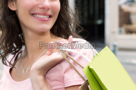 young attractive happy woman shopping in