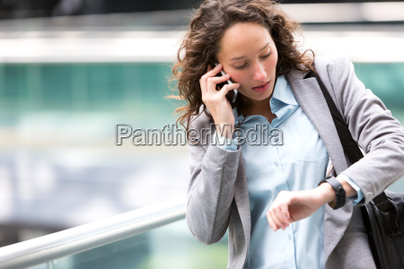 young attractive woman being late to