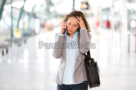 young attractive business woman using smartphone