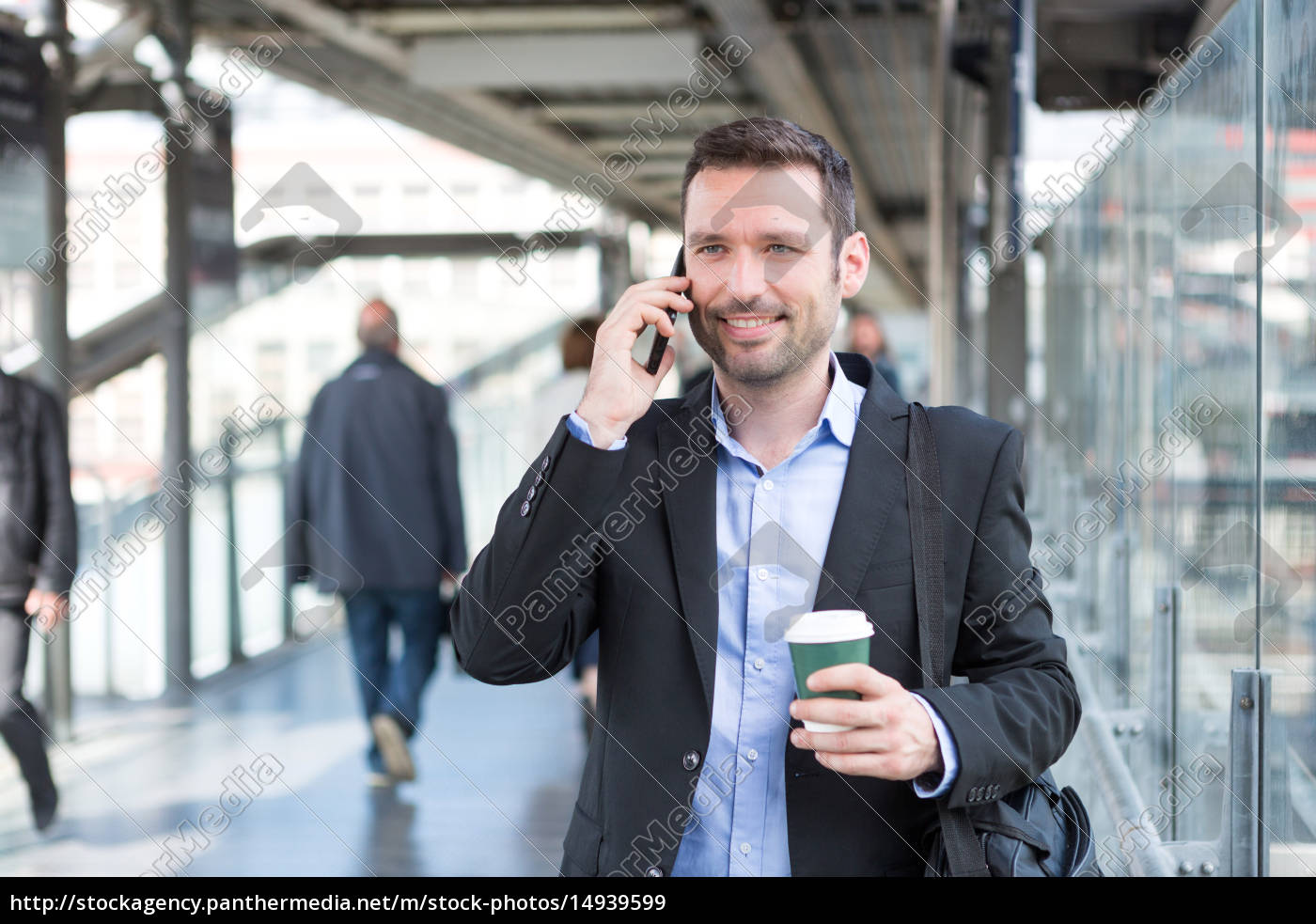 young, attractive, business, man, using, smartphone - 14939599
