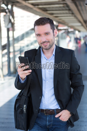 young, attractive, business, man, using, smartphone - 14939619
